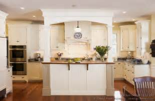 superb Kitchen Backsplash Photos White Cabinets #3: kitchen-cabinets-traditional-white-122-cp021a-victorian-island-wood-hood-wood-floors.jpg