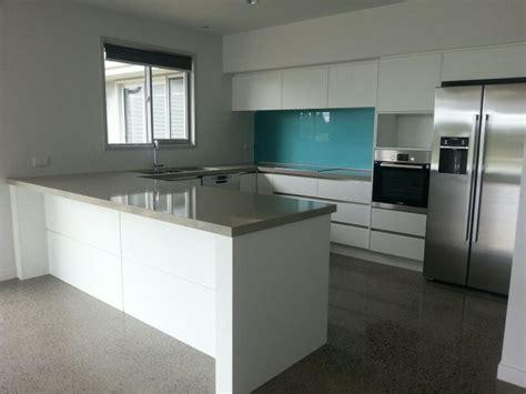 teal kitchen appliances teal splashback bombay white cabinetry irish cream