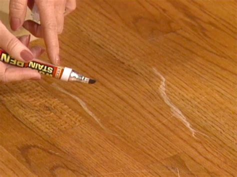 Repair Scratches In Wood Floor How To Touch Up Wood Floors How Tos Diy