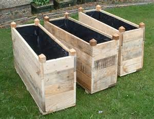 made wooden troughs and planters made from reclaimed