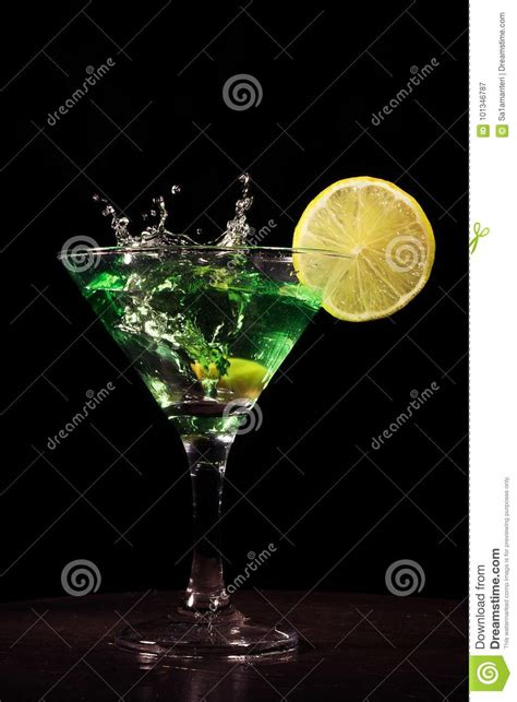 green cocktail black background green cocktail with splash on black background stock image