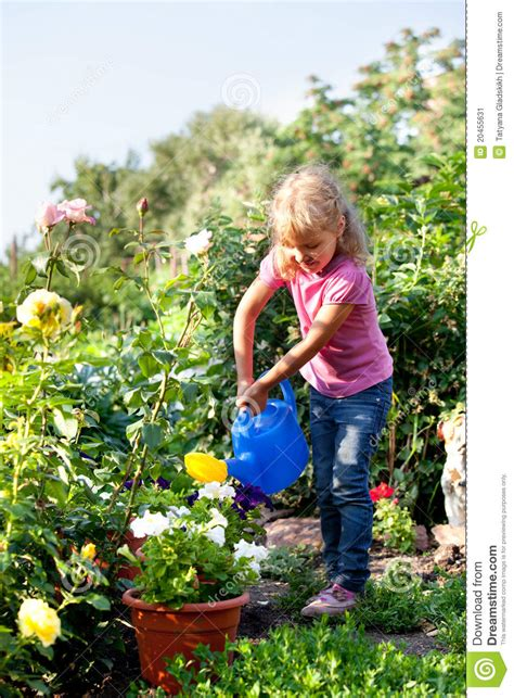 girl watering flowers girl watering flowers are watered from stock image image