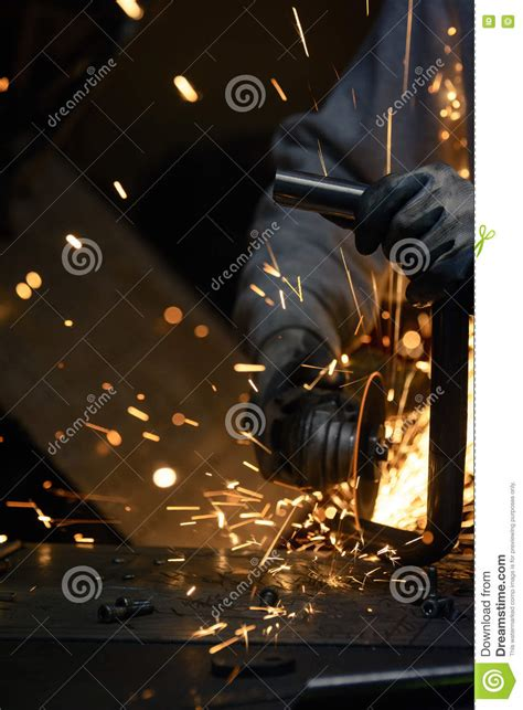worker cutting steel pipe using metal stock photo 380191102 worker cutting metal with grinder sparks flying while steel pipe stock image image