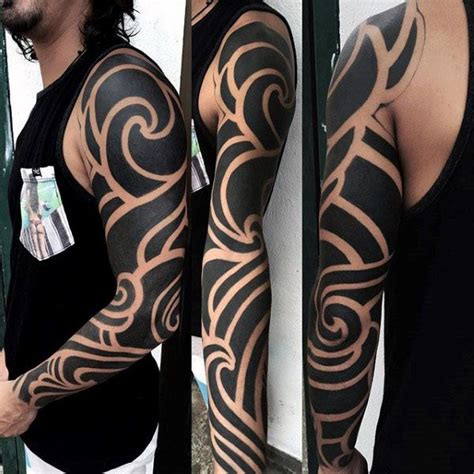 75 tribal arm tattoos for interwoven line design 75 tribal arm tattoos for interwoven line design