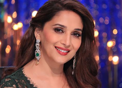 bollywood actress with square face shape madhuri dixit with diamond earrings