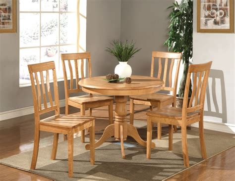 5 pc dinette kitchen table with 4 wood seat chairs