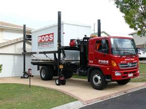 moving and pods storage container on red truck with sturdy black metal buffers and small