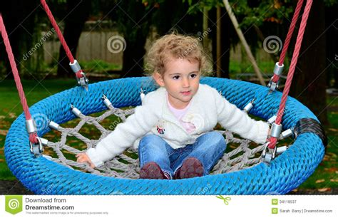 child rope swing young child on a rope swing royalty free stock photography