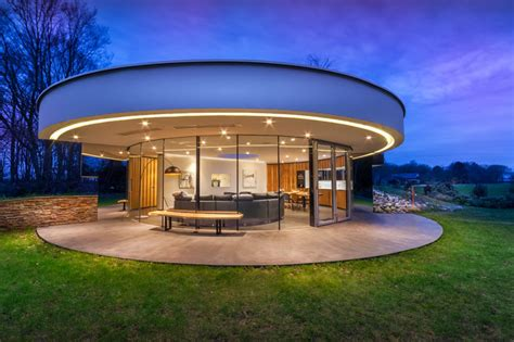circular house this circular house is built into the hillside contemporist
