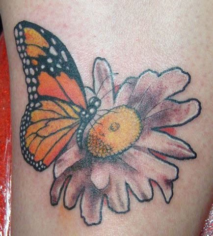 saints and scholars tattoos butterfly and daisy