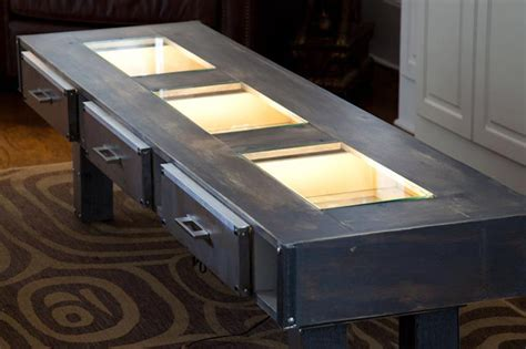 mdc interiors steel and wood glow table provides dramatic
