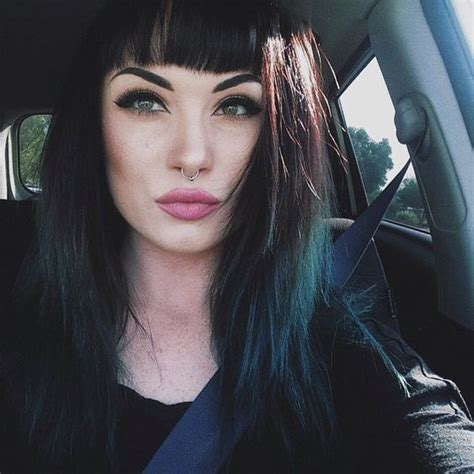 jet black hair for 40 year old woman with red highlights i think i want to cut my bangs like this and dye my hair