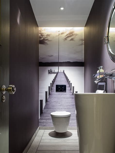 Example of a mid sized trendy powder room design in london with a
