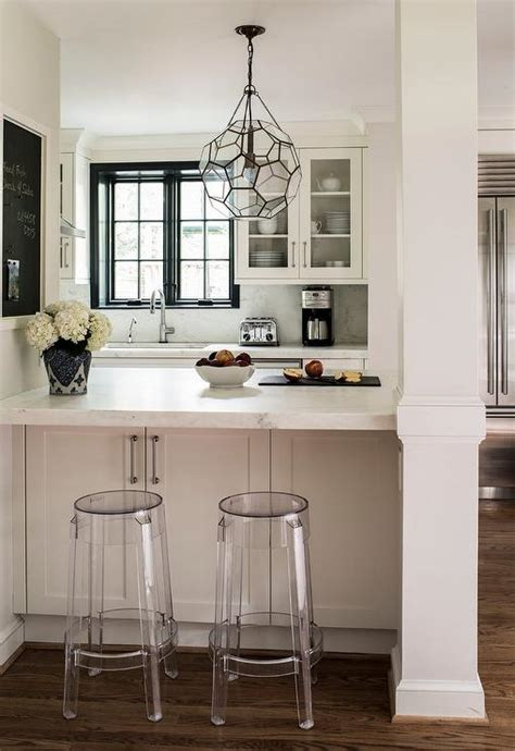 kitchen peninsula with charles ghost stools transitional