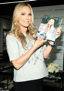 actress career sims 4 molly sims cradles baby bump promoting her book the