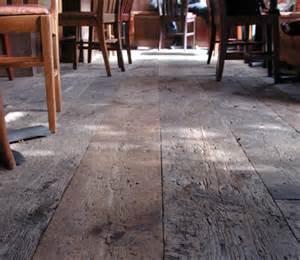 Reclaimed rustic wide plank antique barn threshing wood flooring