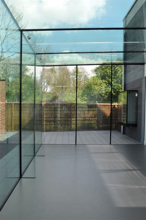 an iron roof and all glass walls structural glass roof with glass fins glasscon gmbh t