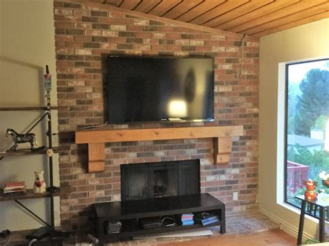 Flat Screen Tv Installation Fireplace by Rustic Fireplace Mantle And Flat Screen Tv Installation In