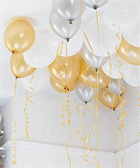 Tropical Themes For Parties - gold silver and white balloons