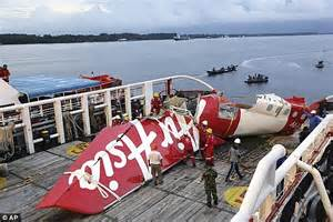 air asia office jakarta airasia copilot s body recovered from crashed plane on sea
