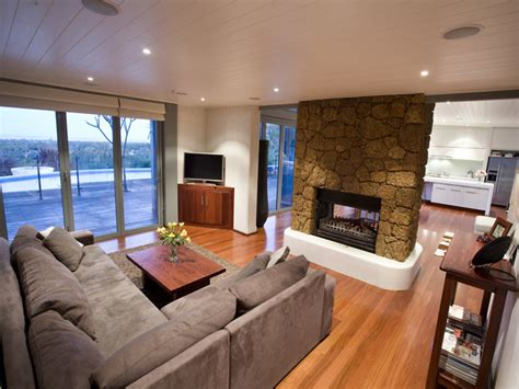 Open plan living room using brown colours with floorboards