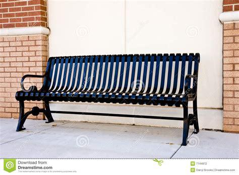 black iron bench black iron bench on sidewalk stock photography image