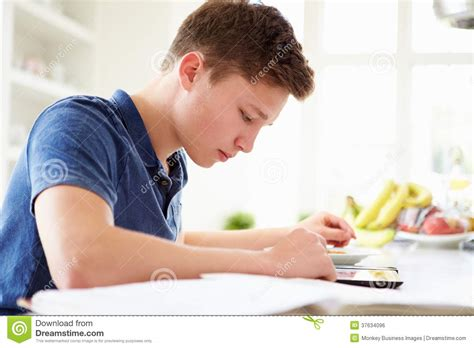 boy studying using digital tablet at home royalty