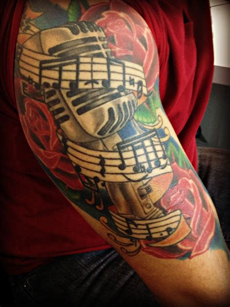 guitar with roses tattoo arm ink arm and tatting