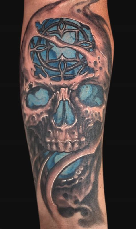 unique skull tattoos realistic skull and swinging on forearm by
