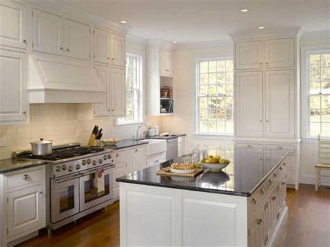 stove opening between cabinets window in corner open shelf under cabinet built in