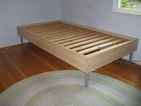 Simple Wooden Bed Frame Simple Wooden Ikea Size Bed Frame With Metal Legs On Braided Rug Decofurnish