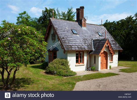 Celtic Cottage by Small Cottage Situated In A Wooden Area Stock Photo