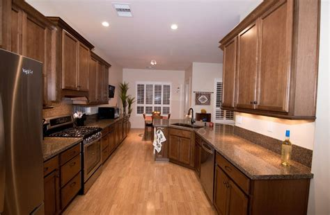 designer kitchens the new generation kitchens kraftmaid kraftmaid maple cognac cabinetry with lg viatera kilauea