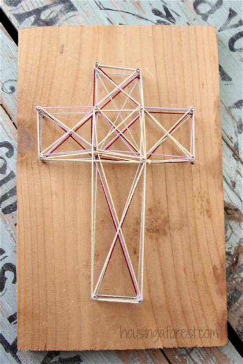 Simple String - string easter cross housing a forest
