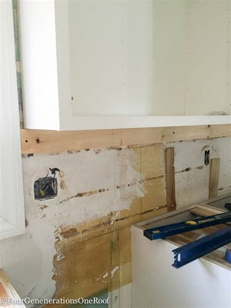 Our Kitchen Renovation Series Installing New Cabinets | our kitchen renovation series installing new cabinets
