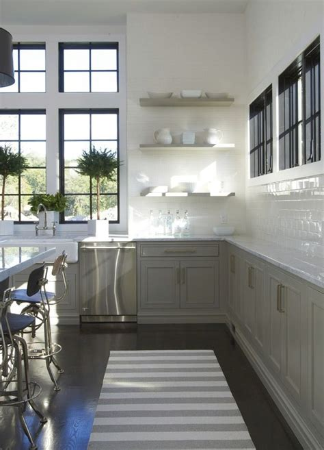 gorgeous black window and white wall tile contrast in this kitchen of grey of the home