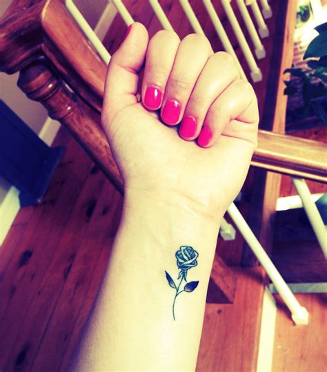 tattoo of a rose my wrist tatto