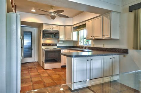 almond kitchen cabinets eating space in kitchen updated almond kitchen cabinets and satillo tile are just waiting for