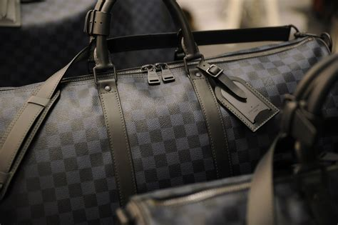 Tas Lv 8398 Bag In Bag backstage and front row at the louis vuitton s fall winter 2014 2015 fashion show in