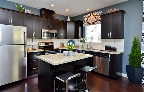 light and dark kitchen cabinets granite countertops dark cabinets stainless steel