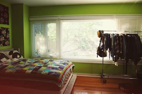 bedroom apparel bedroom clothes clothing rack quilt room image