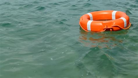 boat accident buoy 10 footage of a red rescue buoy floating on the water surface