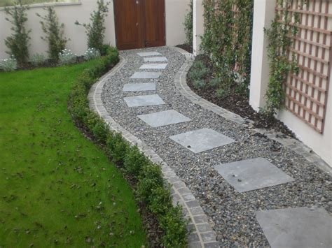Paving Garden Ideas Square Paving Stones In A Curving Gravel Path By A Lawn