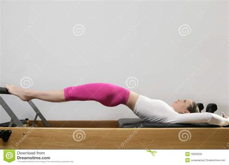 pilates bed gym woman pilates stretching sport in reformer bed stock