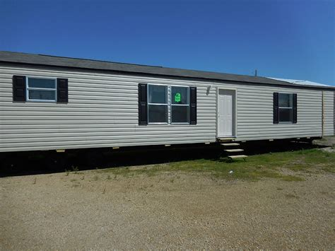 16x80 Mobile Home by New Mobile Homes Town Country Homes Inc