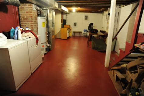 freshly painted basement floor clean clothes rafters br