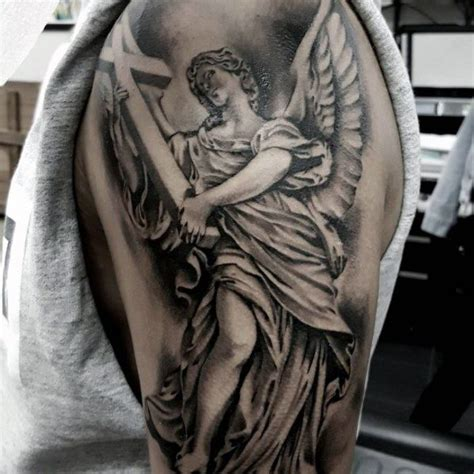 angel holding cross tattoo 52 stunning statue designs about