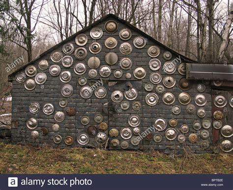 house of hubcaps wall house hubcaps wall decoration design circles round chrome old stock photo