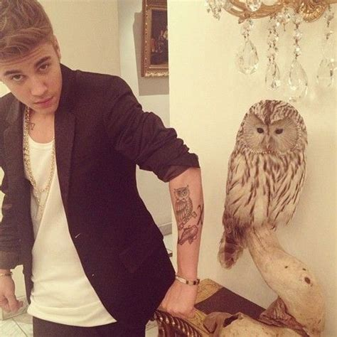 justin bieber owl tattoo artist aw justin comparing his owl tattoo with that owl so cute