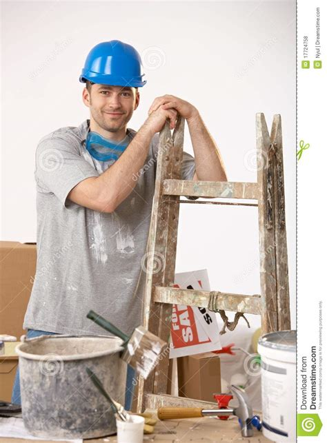 looking for a man who paints houses young guy painting house stock photo image of hammer